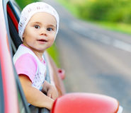 Portrait of happy child girl sticking their head out the car win Stock Photos