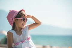 Portrait of Happy Child Girl Tourist At Seaside royalty free stock images