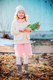 Portrait of happy child girl with tulips for woman's day on the walk in early spring Stock Image