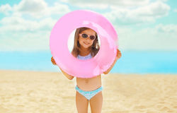 Portrait of happy child with inflatable rubber circle having fun Stock Image