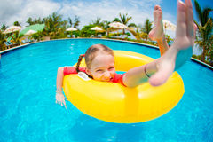 Portrait of happy child with inflatable rubber circle having fun in swimming pool Stock Photography