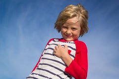 Portrait of a happy child outdoors. With sky copy-space stock photo