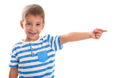 Portrait of a happy child. Smiling boy shows his index finger to the side Royalty Free Stock Photo