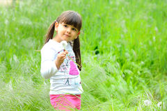 Portrait of happy child in spring. Royalty Free Stock Image
