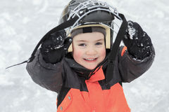 A portrait of happy child in winter play hockey Stock Photography