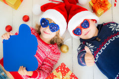 Portrait of happy children with Christmas decorations Royalty Free Stock Photo