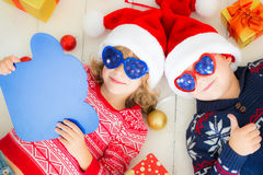 Portrait of happy children with Christmas decorations Stock Photography