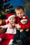 Portrait of happy children with Christmas gift boxes and decorations. Two kids having fun at home Stock Images