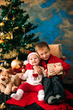 Portrait of happy children with Christmas gift boxes and decorations. Two kids having fun at home Royalty Free Stock Photos