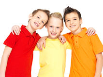 Portrait of the happy children isolated on white. Schoolchild friends standing together and looking at camera Stock Photography