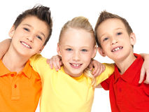 Portrait of the happy children isolated on white. Schoolchild friends standing together and looking at camera Stock Images