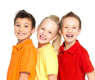 Portrait of the happy children isolated on white. Schoolchild friends standing together and looking at camera royalty free stock images