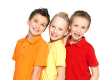 Portrait of the happy children isolated on white. Schoolchild friends standing together and looking at camera Royalty Free Stock Image