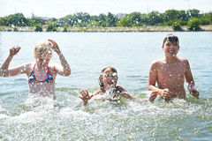Portrait of happy children in lake Royalty Free Stock Image