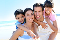 Portrait of happy children with parents spending summer holidays Stock Photo