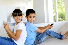 Portrait of happy children playing at home Stock Photos