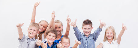Portrait of happy children showing thumbs up Stock Photos