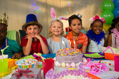 Portrait of happy children at table Stock Photo