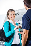 Portrait Of Happy Client Giving Car Keys To Mechanic Royalty Free Stock Photo