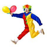 Portrait of a happy clown jumping with balloons Royalty Free Stock Image