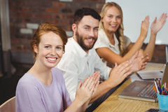 Portrait of happy colleagues clapping at meeting Stock Photos