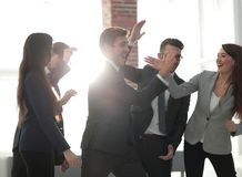 Portrait of a professional business team celebrate their victory. Portrait of happy colleagues congratulating each other on victory Stock Image