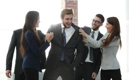Portrait of a professional business team celebrate their victory. Portrait of happy colleagues congratulating each other on victory Royalty Free Stock Image