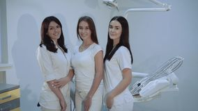Portrait of happy, confident dentists look at camera at dental room. 4K stock video