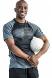 Portrait of happy confident sportsman with rugby ball Royalty Free Stock Image