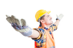 Portrait of happy constructor with arms wide open celebrating su. Ccess, looking up and smile on white background Royalty Free Stock Image