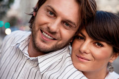 Portrait of a happy couple. Close-up of a young positive couple outdoors stock photo