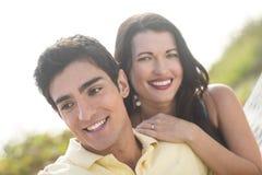 Portrait of happy couple. A close up portrait of a happy couple outdoors Stock Photo