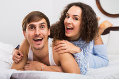 Portrait of happy couple awake in bed Royalty Free Stock Photo