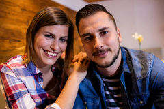 Portrait of happy couple at bar Royalty Free Stock Image