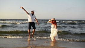Portrait of happy couple on beach. The best honeymoon ever. They spend this time together. Hd, sea, lovers, back view stock video footage