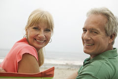 Portrait Of Happy Couple At Beach Royalty Free Stock Photography