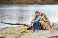 Portrait of the happy couple on the beach, river or lake. Royalty Free Stock Photography