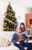 Portrait of Happy couple celebrating Christmas Stock Image