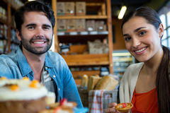 Portrait of happy couple at dessert counter Stock Photography