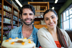 Portrait of happy couple at dessert counter Royalty Free Stock Images