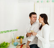 Portrait of a happy couple drinking white wine Royalty Free Stock Photography