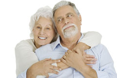 Portrait of happy couple of elderly. Portrait of a happy couple of elderly on white background isolated Royalty Free Stock Image
