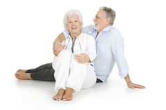 Portrait of a happy couple of elderly. In a white background Royalty Free Stock Photography