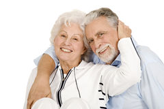 Portrait of a happy couple of elderly. In a white background Stock Photos