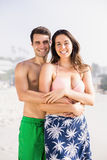 Portrait of happy couple embracing on beach Royalty Free Stock Photos