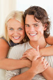 Portrait of a happy couple embracing each other. While looking at the camera Stock Photography