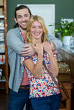 Portrait of happy couple embracing each other in a coffee shop Royalty Free Stock Photography