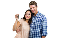 Portrait of happy couple embracing while holding keys Royalty Free Stock Photography