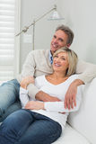 Portrait of a happy couple embracing at home Royalty Free Stock Photo