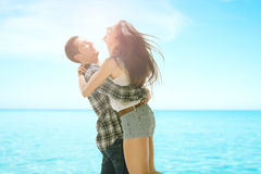 Happy young couple in casual clothes on a beach Royalty Free Stock Image